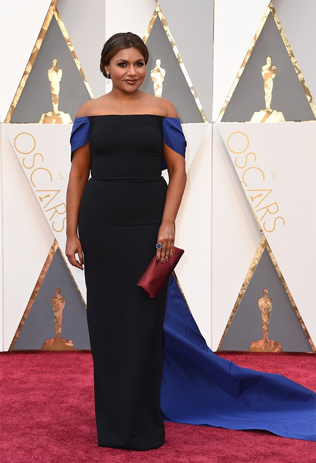 Mindy Kaling looks BEAUTIFUL in an Elizabeth Kennedy gown. The shape is so perfect for her body and that dramatic blue train brings the wow-factor on an otherwise simple design.