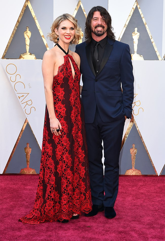 Dave Grohl is here! Yay! And his wife looks totally gorg in this red and black lace gown.