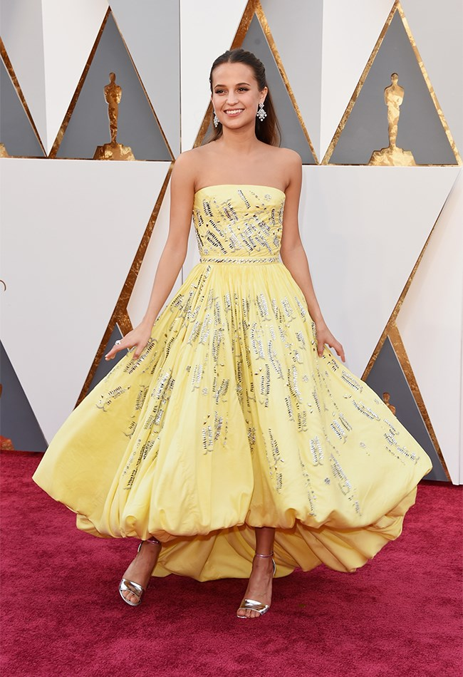 Alicia Vikander is wearing custom Louis Vuitton and we are actually dead with happiness a) because she looks out of this world and b) because she actually looks like Belle from Beauty and the Beast! We have to admit, this is not what we would have expected from her – the colour, the silhouette – but she has absolutely stolen the show, as per usual.
