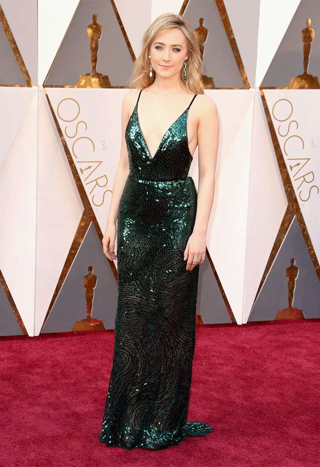 Saoirse Ronan usually goes quite bohemian or ethereal on the red carpet but she has SERIOSULY stepped up the glam for the Oscars in this Calvin Klein collection gown. The deep green colour is a perfect choice for her and she actually said that she wanted to wear green so she could represent her homeland, Ireland. 1, 2, 3, Awwww!