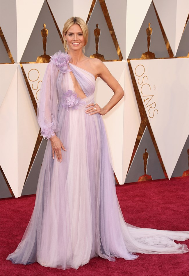 Heidi Klum opted for this lilac, one-shouldered Marchesa gown and YES it's beautiful and YES we loved it on the runway, but we just can't get into it on her for some reason. Maybe we're just used to her being all of the sexy, but this just seems like... a lot. It's a lot.