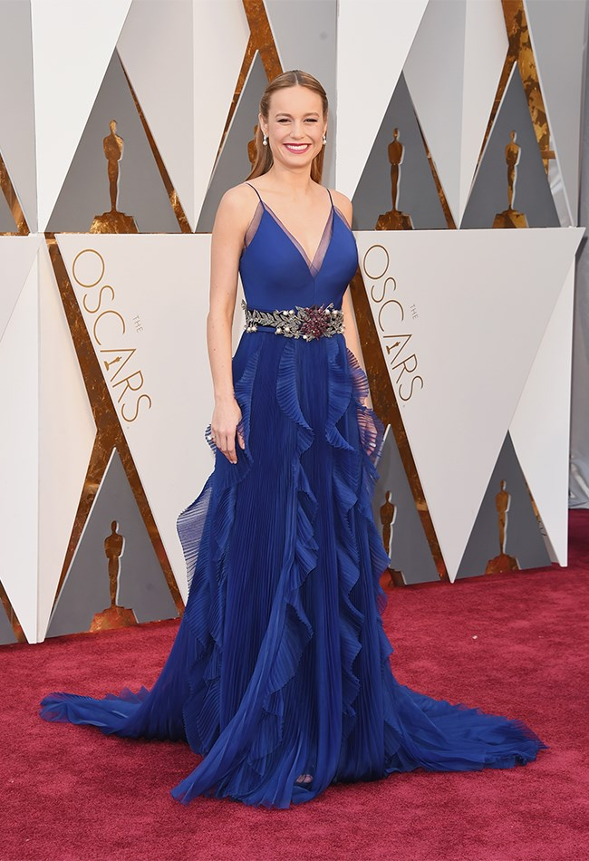 Brie Larson looks divine in royal blue and all of the pleats (we love us some pleats) but the belt and the pearl earrings are a little bit bridal. Also not digging the mumsy lip-colour. Sad face emoji.