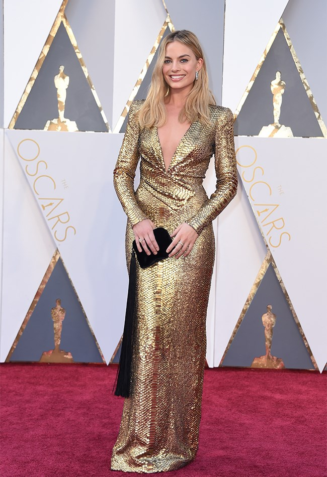 Margot Robbie looks the best we've ever seen her in this gold, long-sleeved gown. She DOES run the risk of looking like an actual Oscar trophy, but we think we're OK with that because JUST LOOK AT HER. Also, that clutch makes us feel things. Good things.