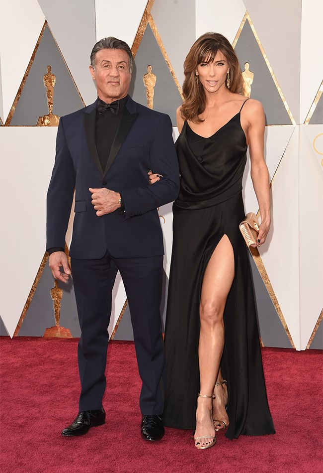 Lol Sylvester Stallone you're like a big huggable bear. Loving his choice of navy suit, And UM HELLO, SYLVESTER STALLONE'S DATE! Jennifer Flavin looks stunning in this slinky, black slip dress.