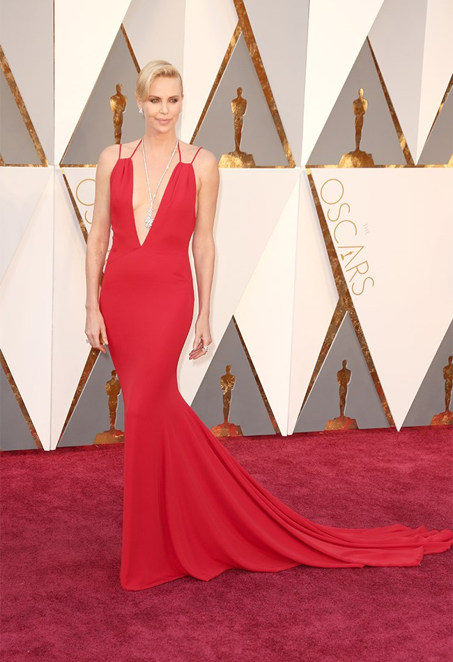 NOT that we're surprised, Charlize Theron looks super sexy in red and diamonds because, Charlize Theron.