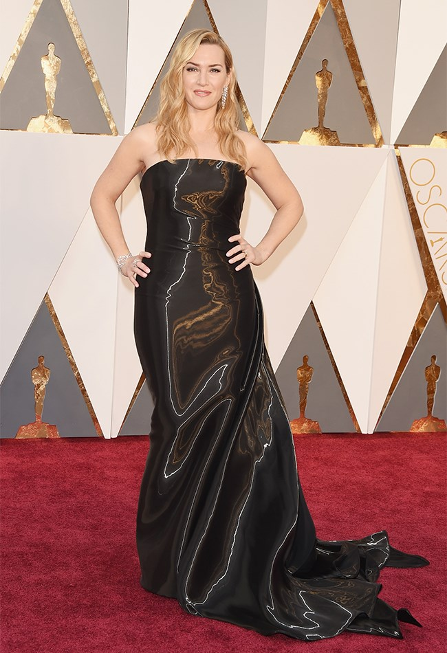 Kate Winslet looks super youthful with lighter hair flowing down by her shoulders. She is wearing a black, strapless Ralph Lauren dress (as she always does) with epic shimmer factor. Alas, her hem is too long and we just aren't excited by it all.