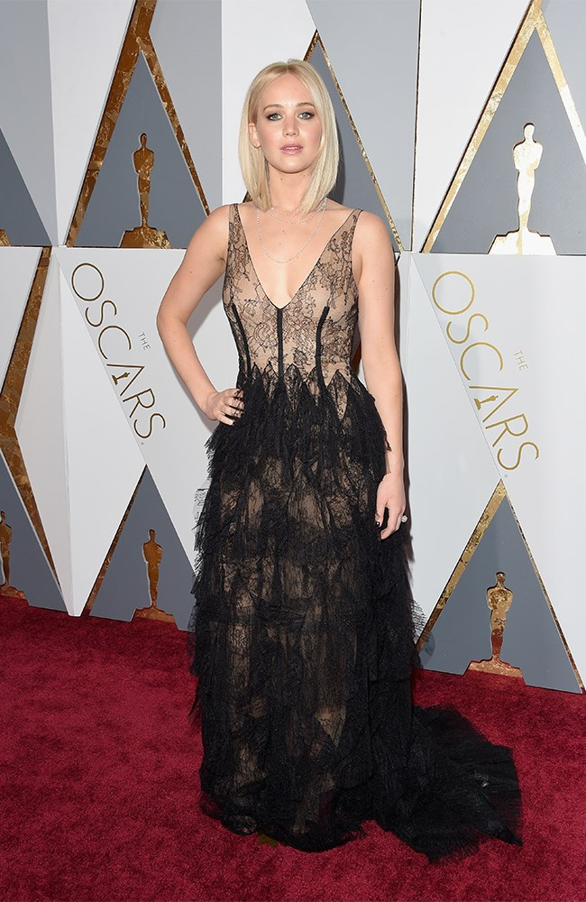 For a minute we thought she wasn't going to show up! She was the last (and latest) to hit the red carpet, but Jennifer Lawrence made it TOTALLY worth the wait in this custom, black lace Dior gown. We thought she would go for something a little more plain, but we're SO GLAD she didn't.