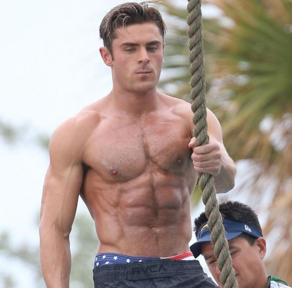 Soooo Zac Efron has taken the role of lifeguard Matt Brody for the film version of Baywatch, and photos of him on set in Miami have surfaced, leaving us all hot and sweaty like...