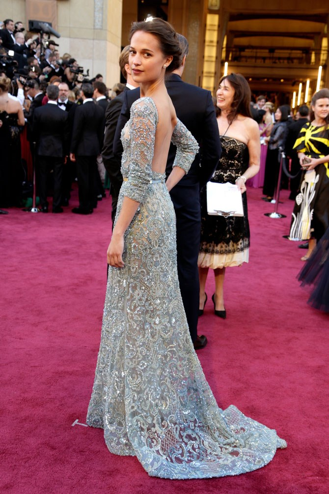 She may have flown under the radar at the 2013 Oscars, but we will never forget her in this Elie Saab gown.
