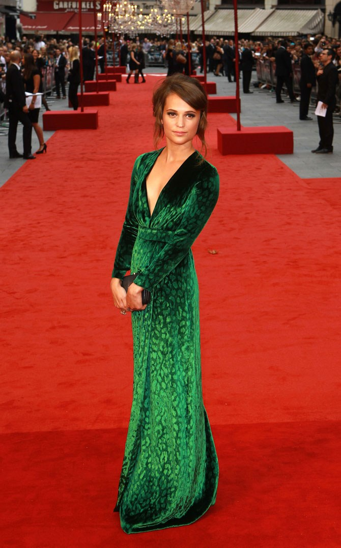 And if anyone could wear a bright green, velvet, leopard print gown and make it look as good as this, we'd love to know about it.