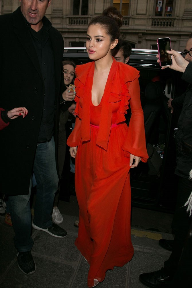 Selena has been in Paris for PFW and, not surprisingly, she has been turning up that style dial. Here she is looking red hot as she arrived at Virgin Radio Station.