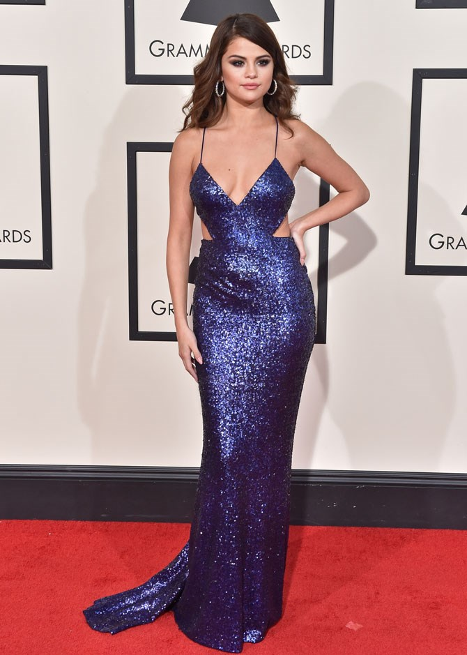 Yep, she loves some sparkle! But we can't go past the sexiness of this dress either, such a great cut.
