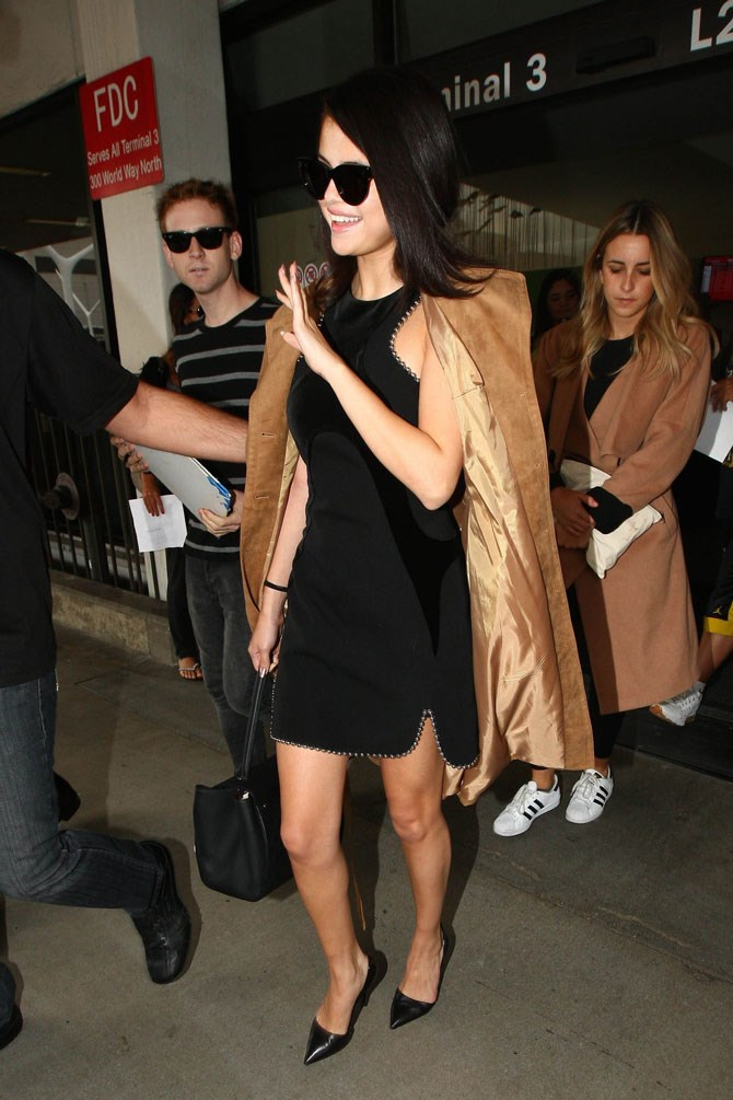All class in a classic LBD and camel coat AKA the perfect combo.