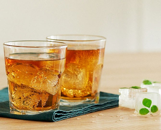 **14. Lucky Leprechaun** Freeze small **clovers** in water in ice cube tray. Add clover ice cubes to a rocks glass. Combine ½ glass **Irish whiskey** with ½ glass **ginger ale.**
