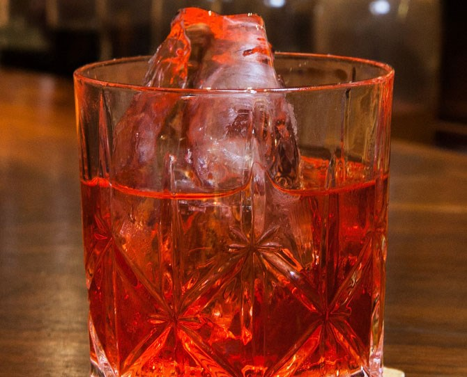 **16. Precision Pilot** In a mixing glass filled with ice, add 1 part **Tullamore D.E.W. Phoenix**, 1 part **Lillet Rosé**, ¾ part **Campari**, and ½ part **Combier Pamplemousse Rosé**. Stir well until chilled and well mixed. Strain into a cocktail glass, add a dash of **Peychaud's bitters**, and express a **grapefruit twist** over the glass before discarding.