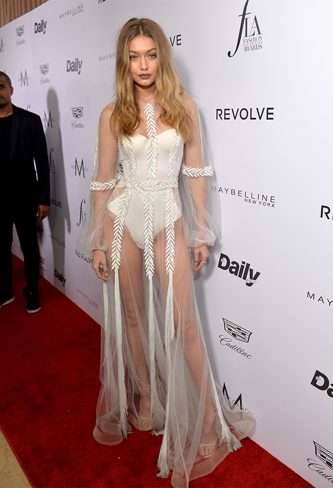 Gigi Hadid attended The Daily Front Row 'Fashion Los Angeles Awards' 2016 wearing the most naked naked dress we've seen so far. But because she's superhuman and never looks anything less than perfect, she somehow manages to make what is essentially a bodysuit with some see through netting over the top look classy AF. BRB, bowing down.
