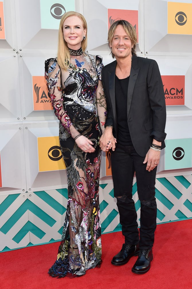 We're loving Nicole Kidman's new found adventurousness when it comes to her red carpet choices. Hubby, Keith Urban, ain't a bad accessory, either.