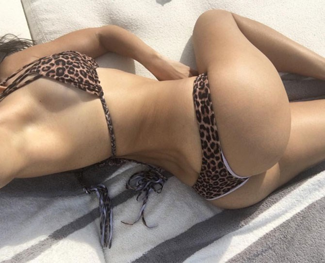 "DAYUM, Kourtney Kardashian. The KUWTK star has posted yet *another*[belfie](http://www.cosmopolitan.com.au/celebrity/celebrity-gossip/2014/5/celebrity-bum-selfies/|target=""_blank"")and lshe ooks seriously hawt. The leopad print bikini is pretty nice too."
