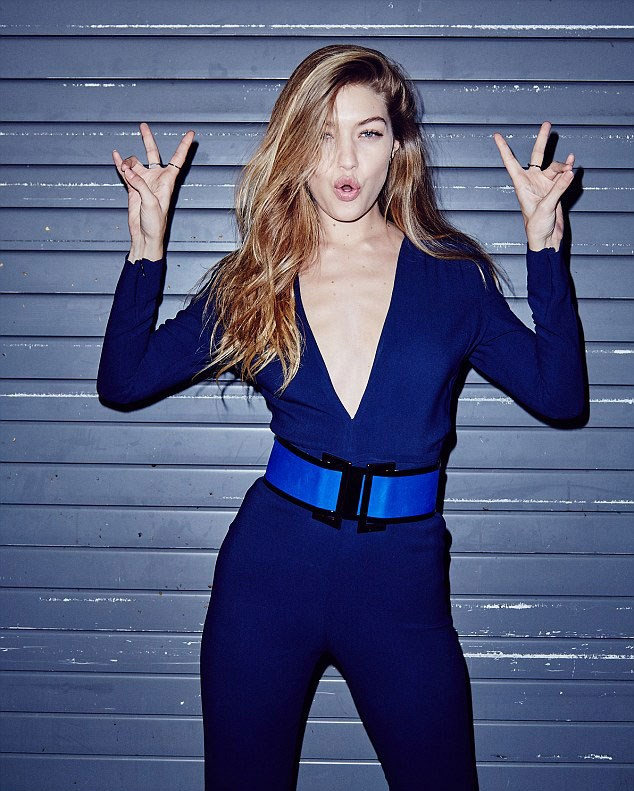 Gigi Hadid is the newest face of Maybelline and these latest brand campaign shots are next-level hot. Wearing a deep-plunging navy jumpsuit, cinched in with a wide statement belt, the blonde bombshell proves, yet again, that she can literally make EVERYTHING look good.
