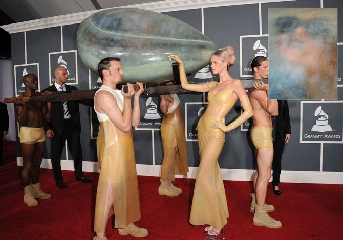 Aaaaand moving right along to the 2011 Grammy Awards, we have Lady Gaga's very understated red carpet entrance, where she was carried by four half-naked men (and a lady for emotional support) whilst she had a little nap in a womb-like pod contraption. Nothin' to see here.