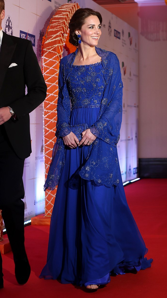 Later that evening Kate wore a stunning royal blue Jenny Peckham evening gown that had hints of Indian-inspired details.