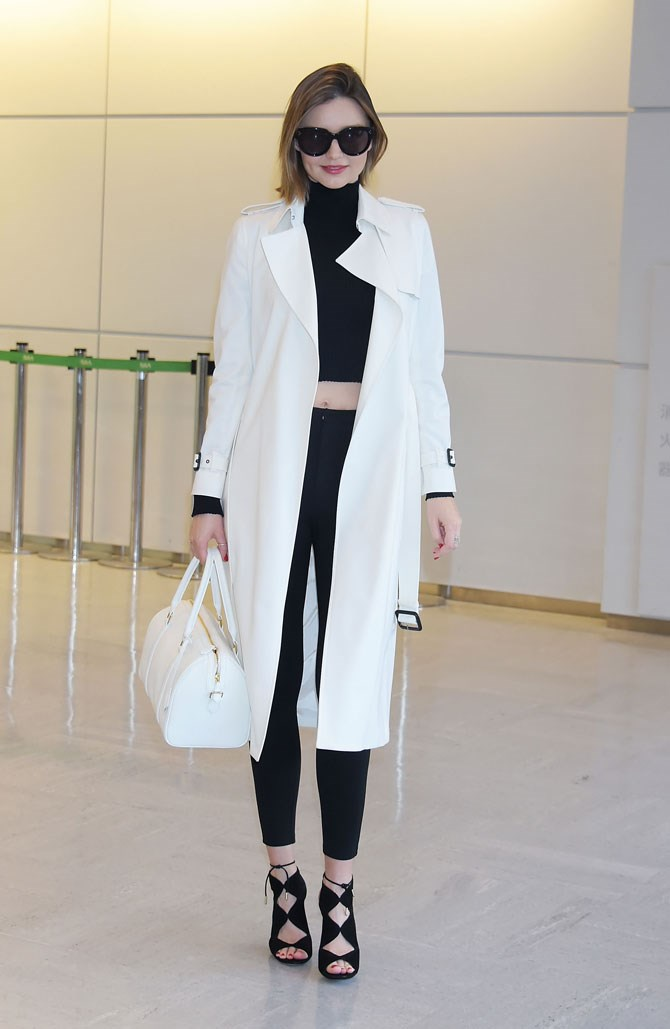 Miranda Kerr was snapped looking super chic in monochrome as she arrived in Japan.