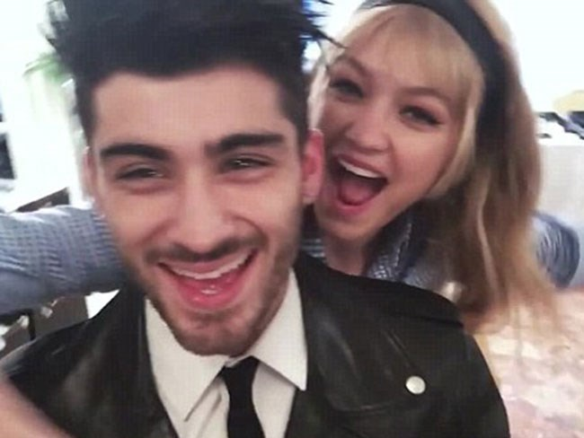 Gigi Hadid and Zayn Malik can't stop making-out in a behind-the-scenes video from their Vogue photoshoot