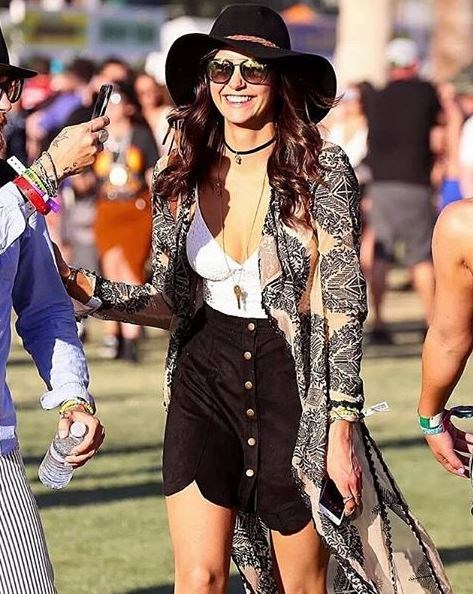 Nina Dobrev was all smiles as she made her way around the grounds.