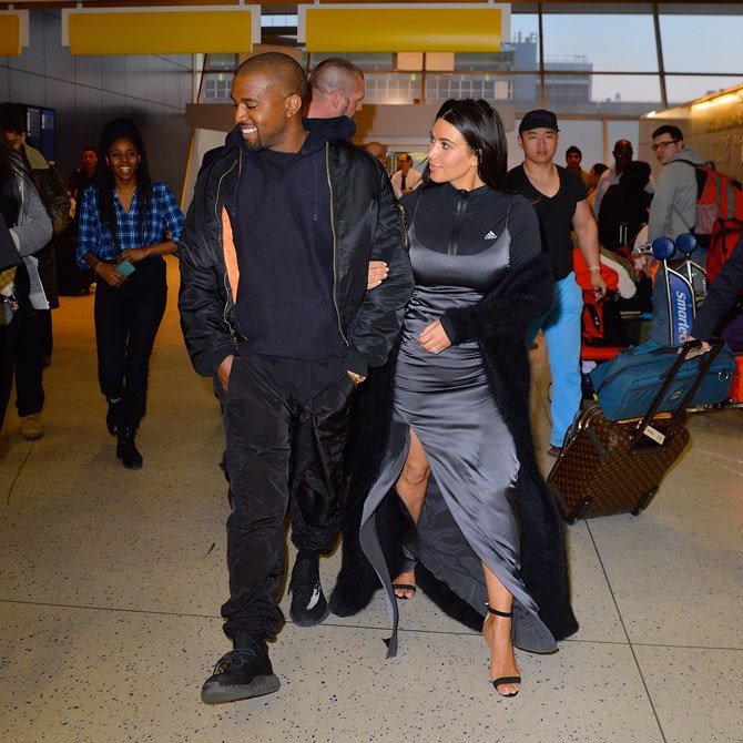 OK so we don't know if we're inspired or confused by this aiport look Kim Kardashian has thrown together. She teamed an Adidas long-sleeve zip-up workout top underneath a super fancy satin slip dress and topped it all off with sky-high heels and a black fuzzy cardigan. It's like athleisure meets red carpet meets meets we don't know what and we can't decide whether it's the future of fashion or just a total lapse in judgement. Did Kanye have something to do with this, do you think? Are they just taking the piss?! We'll never know... until we're wearing it ourselves.