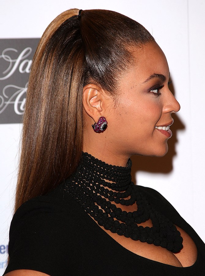 13. We'd forgotten about this slick half-up ponytail, but we're SO happy we found it again. Because, STUNNING.