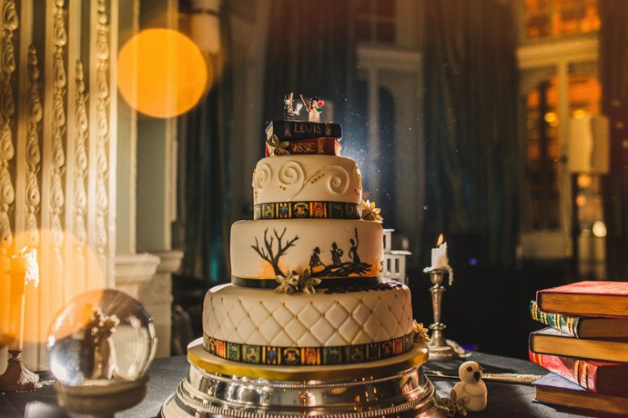 "The incredible cake was complete with all of the House crests, and ode to ""The Tale of the Three Brothers"", and Bellatrix and Voldemort Lego cake-toppers."