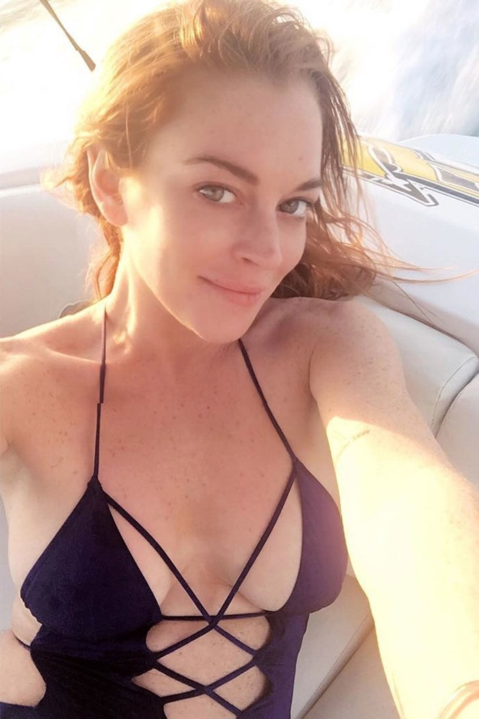 """Lindsay Lohan's sexy AF black lace-up one-piece brought all of the sexy vibes to her """"super"""" Saturday, which she spent on a boat."""