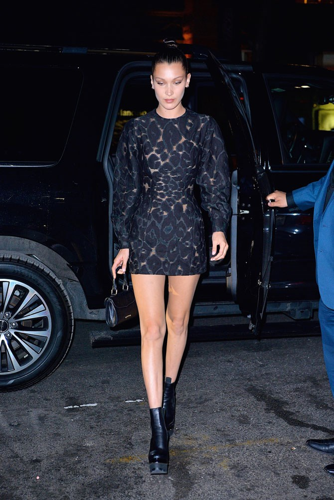 Not everyone can pull of a puffy sleeve (or a see-through dress, for that matter) but she seems to make it look completely normal.