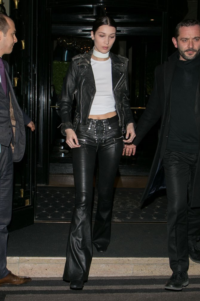 Like, COME ON! There aren't many people out there who can make flared leather lace-up pants look good.