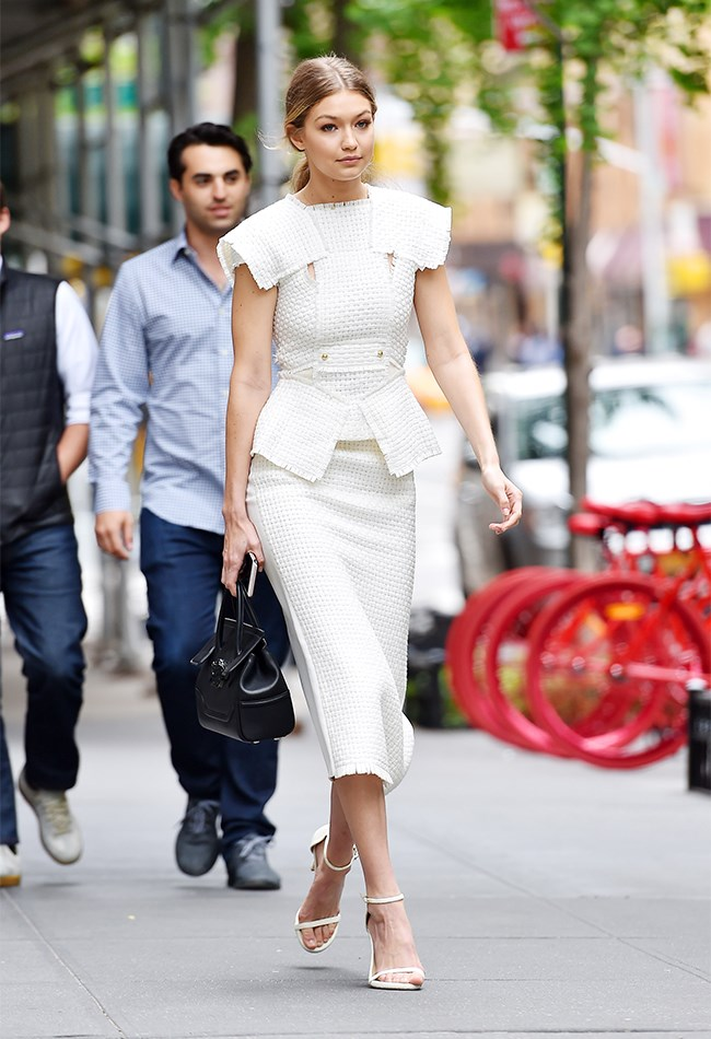 Oh hey, businesswoman chic! We're loving this structured white dress on her.
