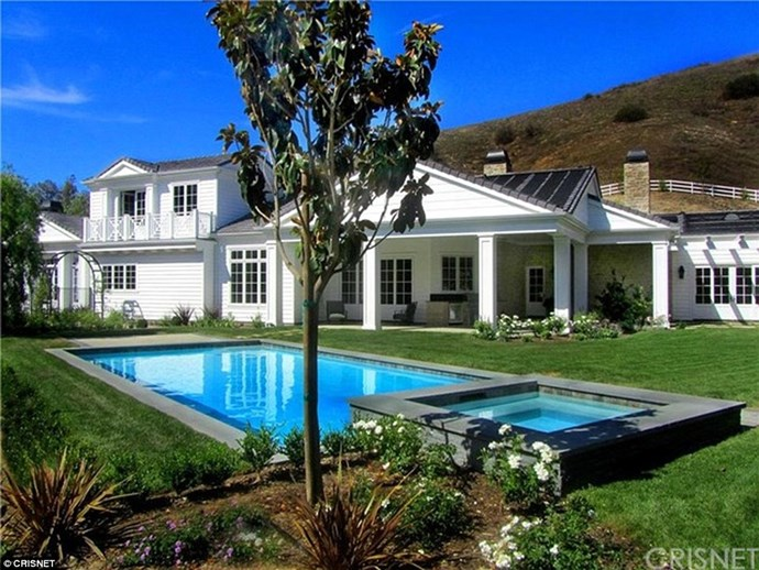 After her very recent split from Tyga, Kylie Jenner could probably use some cheering up. So it's lucky King Kylie has an insane $8.3 million mansion to call home! The enormous luxury property is in the southern California 'hood Hidden Hills, where Kris Jenner and Kim Kardashian already have homes, so no doubt she's going to have a lot of visitors stopping by. Especially in the summer - look at that pool.
