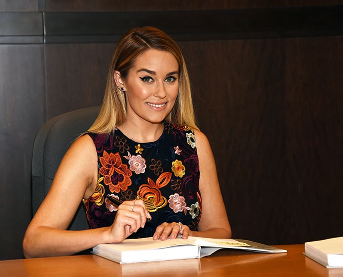 **NOW** ** ** Who gives a flying f*ck about Paris when you're Lauren Conrad? She's launched a successful clothing label or four, is the queen of entertaining and has just published her ninth book. She's also married to a totally baben guy called William Tell that used to be in an angsty 00s punk rock band but now he's a lawyer. She also still has Chloe the dawg. Got it mayyyyde, gurl.