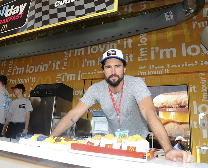 **NOW** ** ** He works at McDonalds. We kid! This is from some sort of charity thang. Because Brody is still famous AF. Helps he (used to be) step-siblings of the Kardashian so he experienced many a KUWTK cameo. He dated Sk8er Grl Avril Lavigne for a while but now he's engaged to a model Kaitlynn Carter and all is right in the world, it seems.