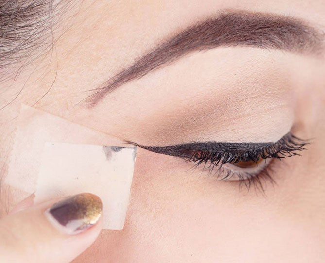 "**Master Liquid Eyeliner.**   Use a small piece of scotch tape to flawlessly apply liquid eyeliner every time.   Get the tutorial at [Harper's Bazaar.](http://www.harpersbazaar.com/beauty/makeup/advice/g3741/liquid-eyeliner-tape-trick-how-to/|target=""_blank"")"