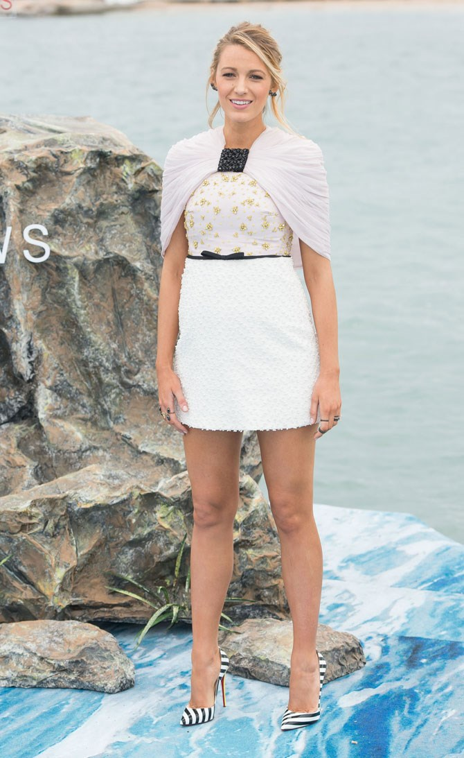 It literally does not get any cuter than this belted and caped mini dress.