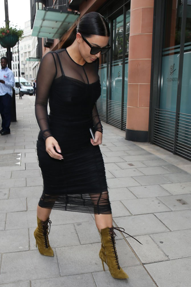 How to make a plain black midi dress look next-level: add the sickest pair of lace up boots you can find.