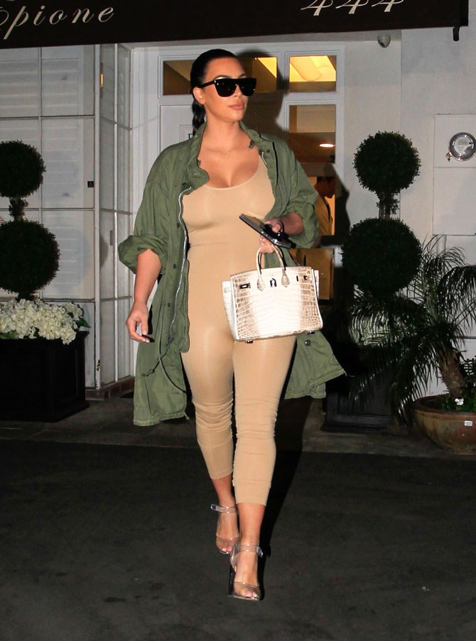 SERIOUSLY! Who the heck else do you know that could wear a nude unitard just months after giving birth and make it look like the hottest sh*t ever?! THERE LITERALLY IS NO ONE ELSE!