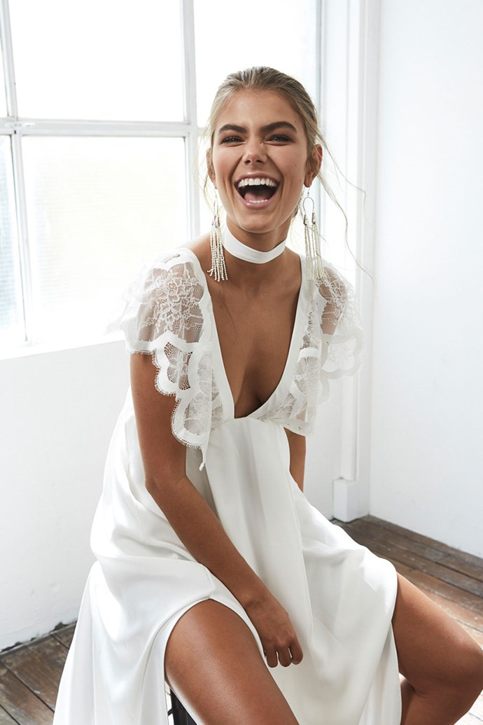 We love the strong contrast between the simple, clean, white silk and the delicate lace.