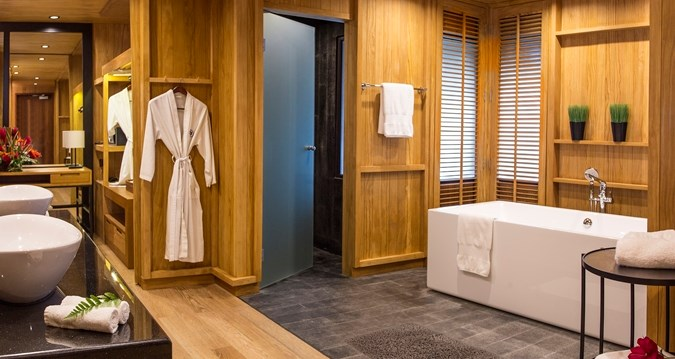 Welcome to your gigantic bathroom and walk-in robe!