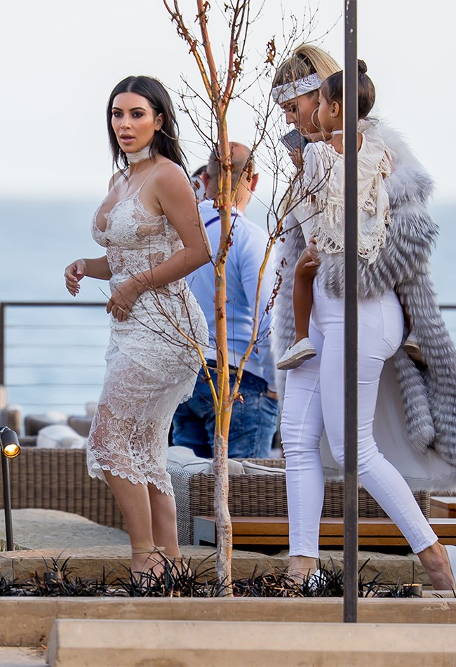 KKW was pretty much naked at Scott Disick's birthday party. Because why not, when you look this good?