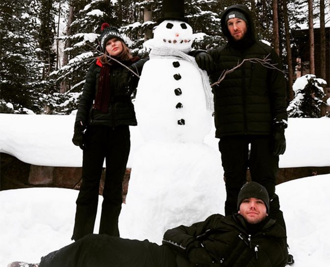 **December 2015** Do you want to build a snowman? Yup. With Taylor's bro Austin in tow. He hangs out with the fam bam too.