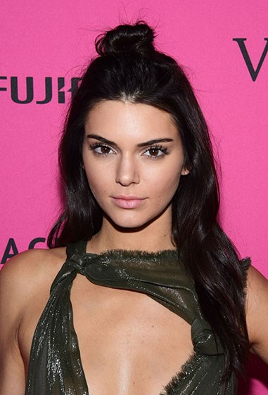 **1. Kendall Jenner** Kenny opts for a messy top knot to show off her bangin' brows while the rest of her hair flows free.