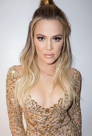 **2. KhloéKardashian** Sister Khlo's on-board the half-up train too, pulling out bits of her bangs at the front to create a more flattering shape around her face. We're totes diggin' the cheerleader vibes btw <33