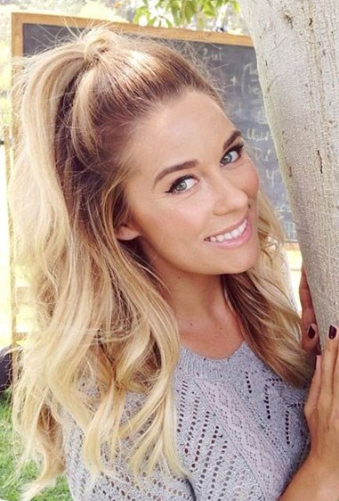 **4. Lauren Conrad** LC looks cute as a button with her high pony, taking a strand of hair and wrapping it around to hide the elastic (which is actually a *great*idea).