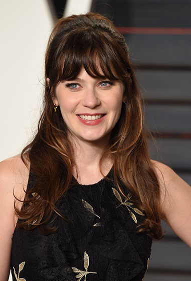 **10. Zooey Deschanel** Zooey's probs been reppin' this look for the longest, using the trick to prevent too much hair falling on her face - a legit problem for peeps with fringes.